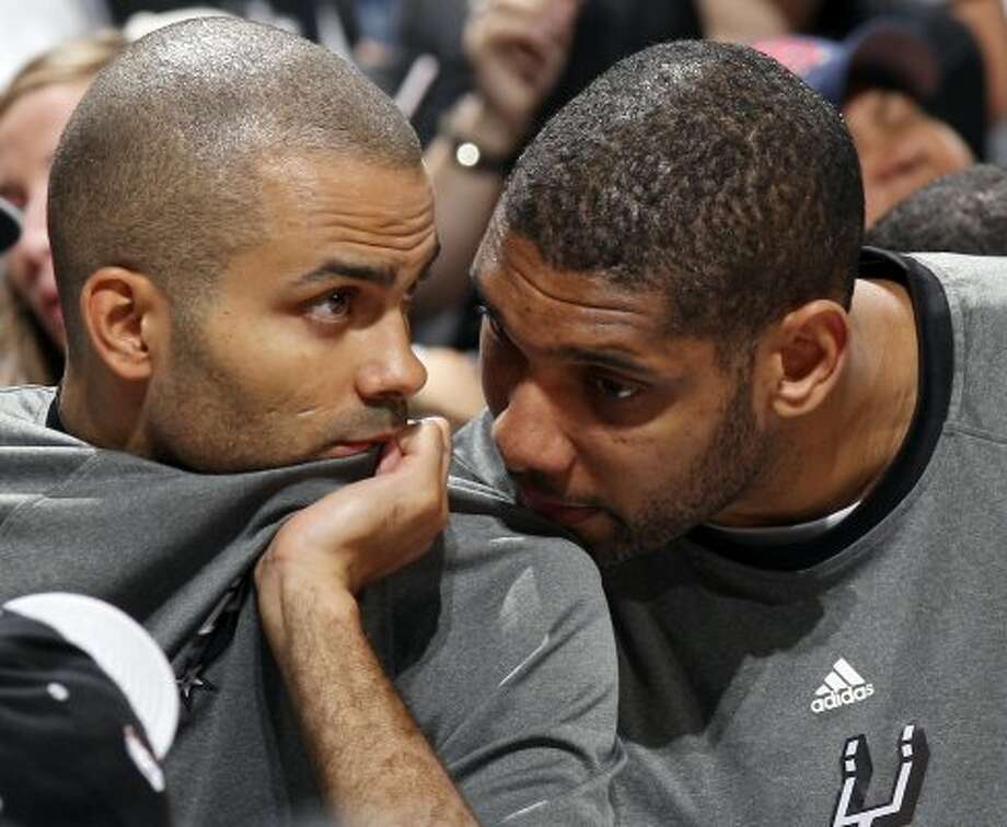 The Spurs'  Tony Parker and Tim Duncan talk on the bench during second half action of Game 2 of the Western Conference first round against the Utah Jazz Wednesday May 2, 2012 at the AT&T Center. The Spurs won 114-83.  EDWARD A. ORNELAS/SAN ANTONIO EXPRESS-NEWS (EDWARD A. ORNELAS / SAN ANTONIO EXPRESS-NEWS)