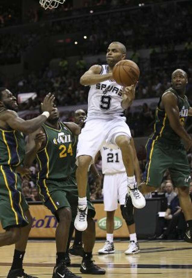 The Spurs'  Tony Parker passes the ball out to the perimeter as he is surrounded by Jazz defenders during the first half of game two of the Western Conference first round at the AT&T Center, Sunday, May 2, 2012. Jerry Lara/San Antonio Express-News (Jerry Lara / San Antonio Express-News)