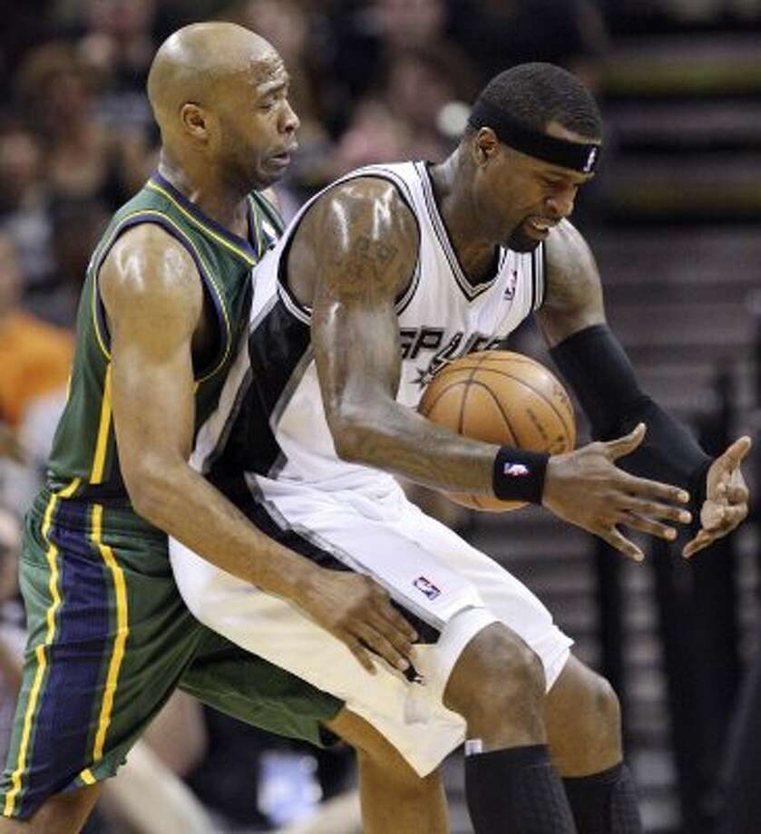 The Spurs'  Stephen Jackson and Jazz's Jamaal Tinsley struggle for control of the ball during first half action of Game 2 of the Western Conference first round Wednesday May 2, 2012 at the AT&T Center.  EDWARD A. ORNELAS/SAN ANTONIO EXPRESS-NEWS (EDWARD A. ORNELAS / SAN ANTONIO EXPRESS-NEWS)
