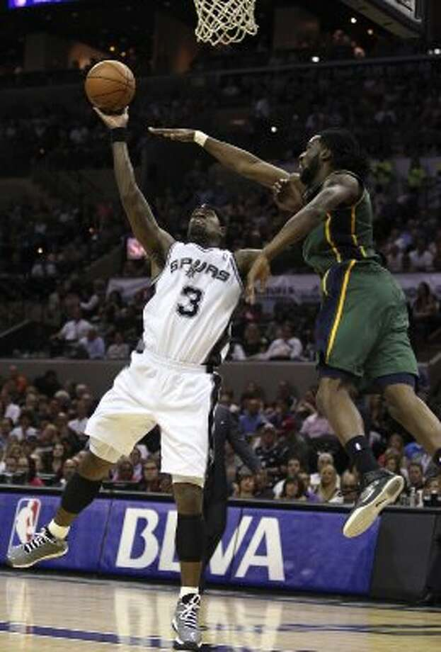 The Spurs'  Stephen Jackson keeps the ball away from the Jazz's DeMarre Carroll during the first half of game two of the Western Conference first round at the AT&T Center, Sunday, May 2, 2012. Jerry Lara/San Antonio Express-News (Jerry Lara / San Antonio Express-News)