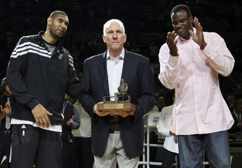 FOR SPORTS - San Antonio Spurs head coach Gregg Popovich holds the Red Auerbach trophy as Tim Duncan and David Robinson look on before Game 2 of the Western Conference first round against the Utah Jazz Wednesday May 2, 2012 at the AT&T Center.  (PHOTO BY EDWARD A. ORNELAS/SAN ANTONIO EXPRESS-NEWS) (SAN ANTONIO EXPRESS-NEWS)