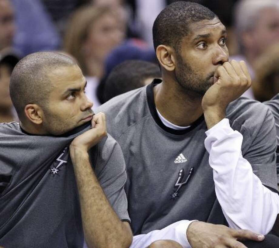 FOR SPORTS - San Antonio Spurs Tony Parker and Tim Duncan watch second half action of Game 2 of the Western Conference first round against the Utah Jazz from the bench Wednesday May 2, 2012 at the AT&T Center. The Spurs won 114-83.  (PHOTO BY EDWARD A. ORNELAS/SAN ANTONIO EXPRESS-NEWS) (SAN ANTONIO EXPRESS-NEWS)