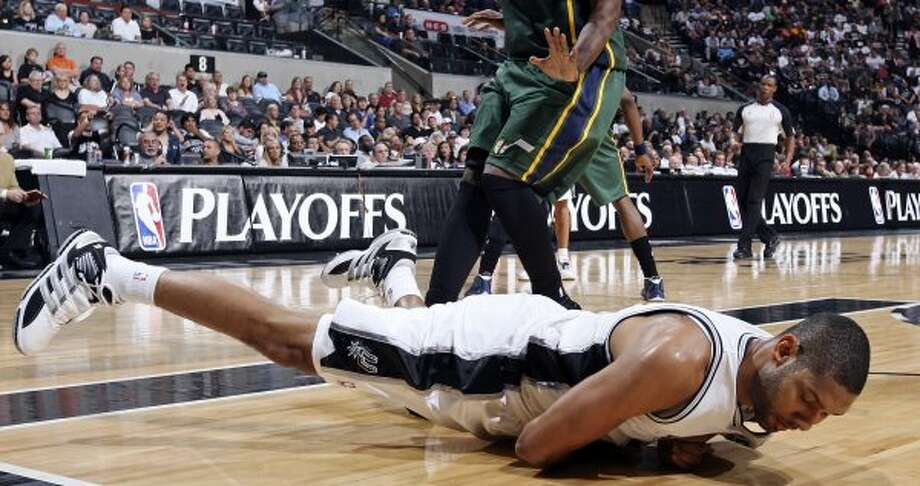 FOR SPORTS - San Antonio Spurs Tim Duncan falls after slipping during second half action of Game 2 of the Western Conference first round against the  Utah Jazz Wednesday May 2, 2012 at the AT&T Center. The Spurs won 114-83.  (PHOTO BY EDWARD A. ORNELAS/SAN ANTONIO EXPRESS-NEWS) (SAN ANTONIO EXPRESS-NEWS)