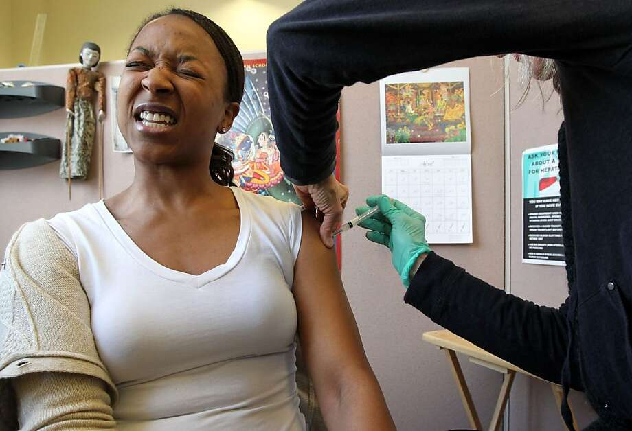Sylvia Ojeh of El Sobrante reacts to a shot of Tdap vaccine that guards against tetanus, diphtheria and pertussis, or whooping cough, in San Francisco. Photo: Lance Iversen, The Chronicle