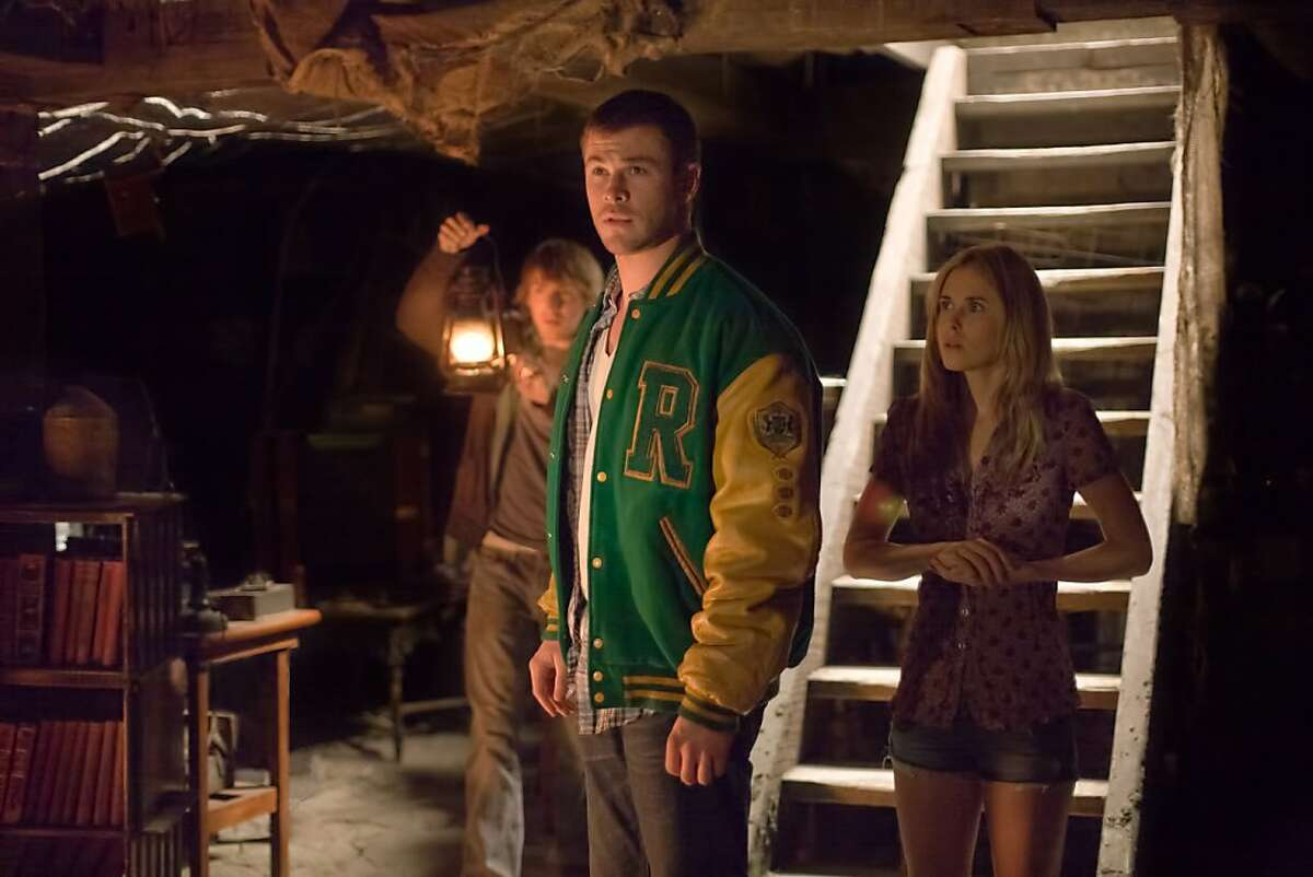 """In this film image released by Lionsgate, from left, Fran Kranz, Chris Hemsworth and Anna Hutchison are shown in a scene from """"The Cabin in the Woods."""" (AP Photo/Lionsgate, Diyah Pera)"""