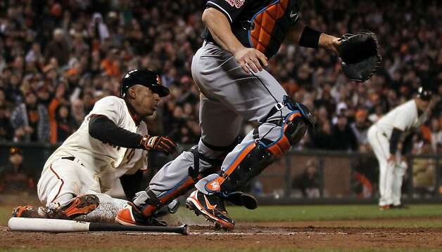 San Francisco Giants Joaquin Arias scores the tying run in the bottom of the 9th inning off a base hit by Gregor Blanco against the Miami Marlins Wednesday, May 2, 2012 in San Francisco Calif. Photo: Lance Iversen, The Chronicle