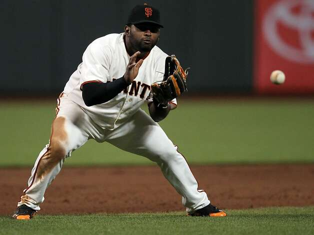 San Francisco Giants Pablo Sandoval catches a line drive by Miami Marlins Jose Reyes during the sixth inning of their MLB baseball game Wednesday, May 2, 2012 in San Francisco Calif. Photo: Lance Iversen, The Chronicle