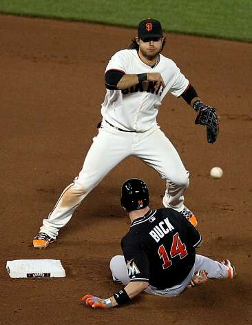 San Francisco Giants Brandon Crawford turns the double play in the 8th inning against the Miami Marlins Wednesday, May 2, 2012 in San Francisco Calif. Photo: Lance Iversen, The Chronicle