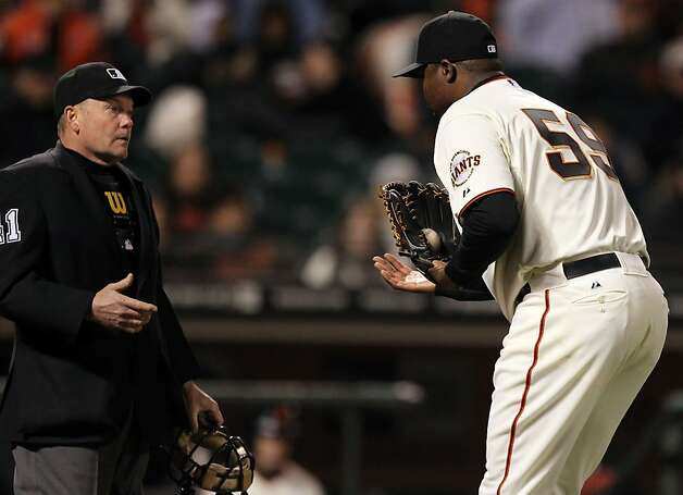 San Francisco Giants pitcher Guillermo Mota questions umpire Jerry Meals strike zone during their game against the Miami Marlins Wednesday, May 2, 2012 in San Francisco Calif. Marlins won 3-2 in ten innings. Photo: Lance Iversen, The Chronicle