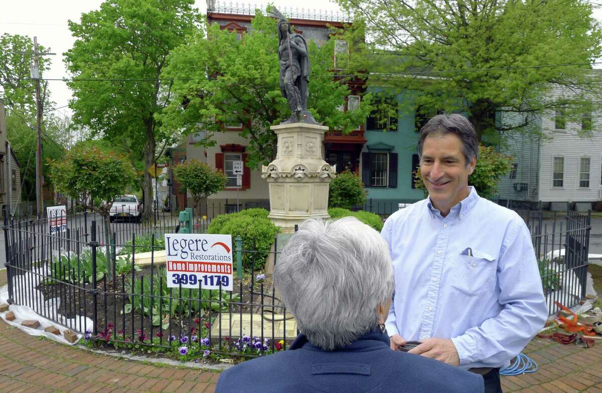 Ray Legere of Legere Restorations talks with Connie Colangelo prior to the removal of Lawrence the Indian, the iconic 125-year-old statute that sits in the heart of the Stockade, from his pedestal for maintenance in Schenectady N.Y. Wednesday May 2, 2012. (Michael P. Farrell/Times Union)