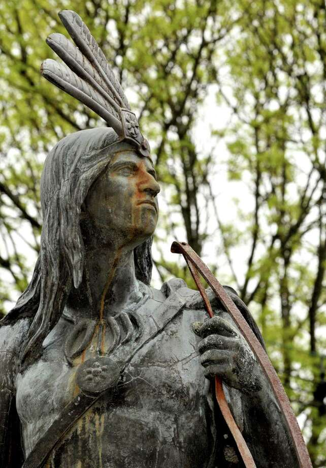 Lawrence the Indian, the iconic 125-year-old statute that sits in the heart of the Stockade, was  removed from his pedestal in Schenectady N.Y. Wednesday May 2, 2012. The statue, which has stood at the junction of North Ferry, Front and Green Streets since 1887, is in need of restoration work. Lawrence was named after a Mohawk who befriended rearly settlers. (Michael P. Farrell/Times Union) Photo: Michael P. Farrell, Albany Times Union / 00017537A