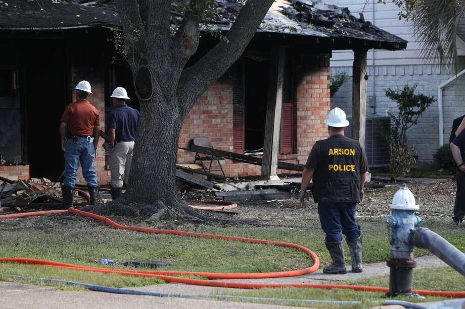 A woman was found dead inside a house after fire charred portions of the home  in southeast Houston early Thursday morning. The fire broke out about 1:20 a.m. at the house in the 10500 block of  Sagetree near Sagecliff. Photo: Johnny Hanson, Houston Chronicle