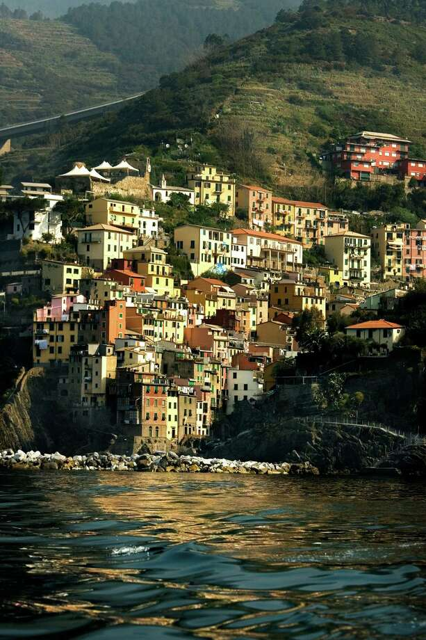 Riomaggiore, the easternmost of the Cinque Terre villages, seems to tumble into the water. (Bill Hogan/Chicago Tribune/MCT) Photo: Bill Hogan / Chicago Tribune