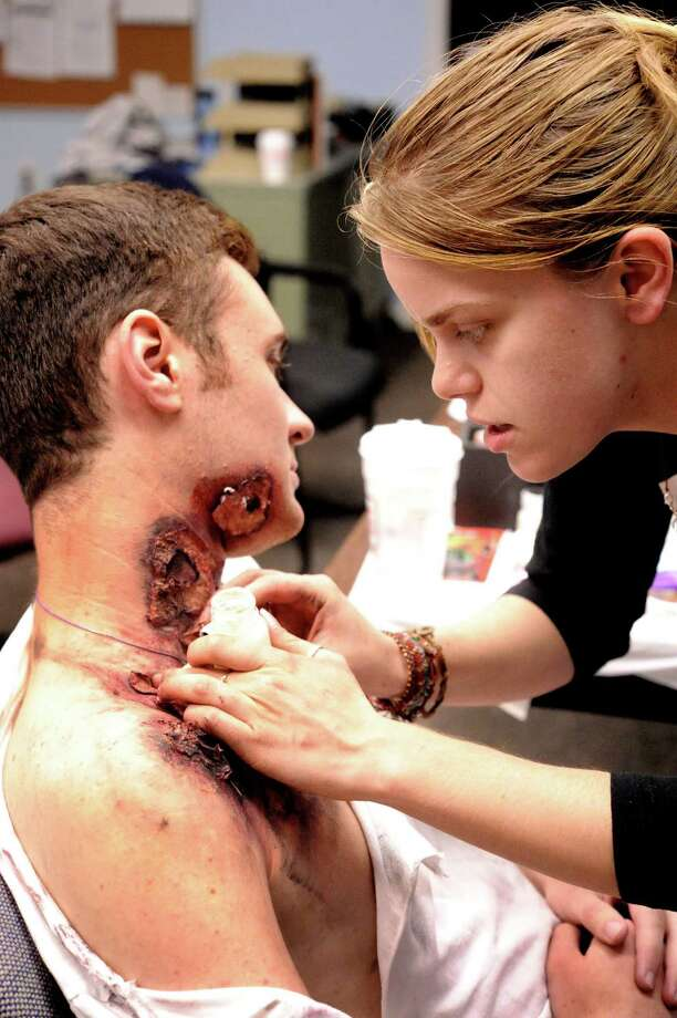 Dan Manning, 18, of Bethel High School is given the appearence of a third-degree burn victim by make-up artist Jessica Rosetti during the EMS Olympics at the South Street Firehouse in Bethel Thursday, May 3, 2012. Photo: Michael Duffy / The News-Times