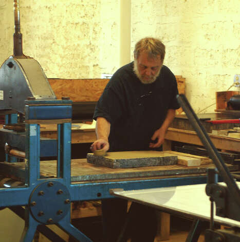 Master printer James Reed works in his printmaking studio, which is located in Bridgeport. Reed, who first set up shop in Connecticut in 1980, is celebrating 30 years of creative collaborations with a retrospective exhibit at the 22 Haviland Street Gallery in South Norwalk. The show, which features works from three dozen artists, including Reed, opens Thursday, May 3, 2012. It runs through June 24. Photo: Contributed Photo