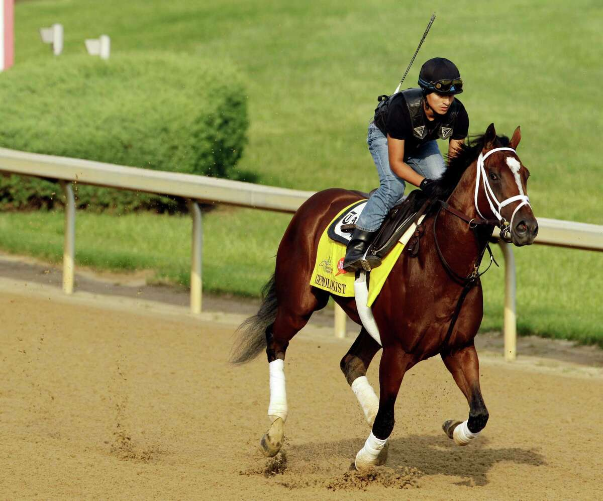 Exercise rider Hector Ramos takes Kentucky Derby entrant Gemologist for a workout at Churchill Downs Thursday, May 3, 2012, in Louisville, Ky.