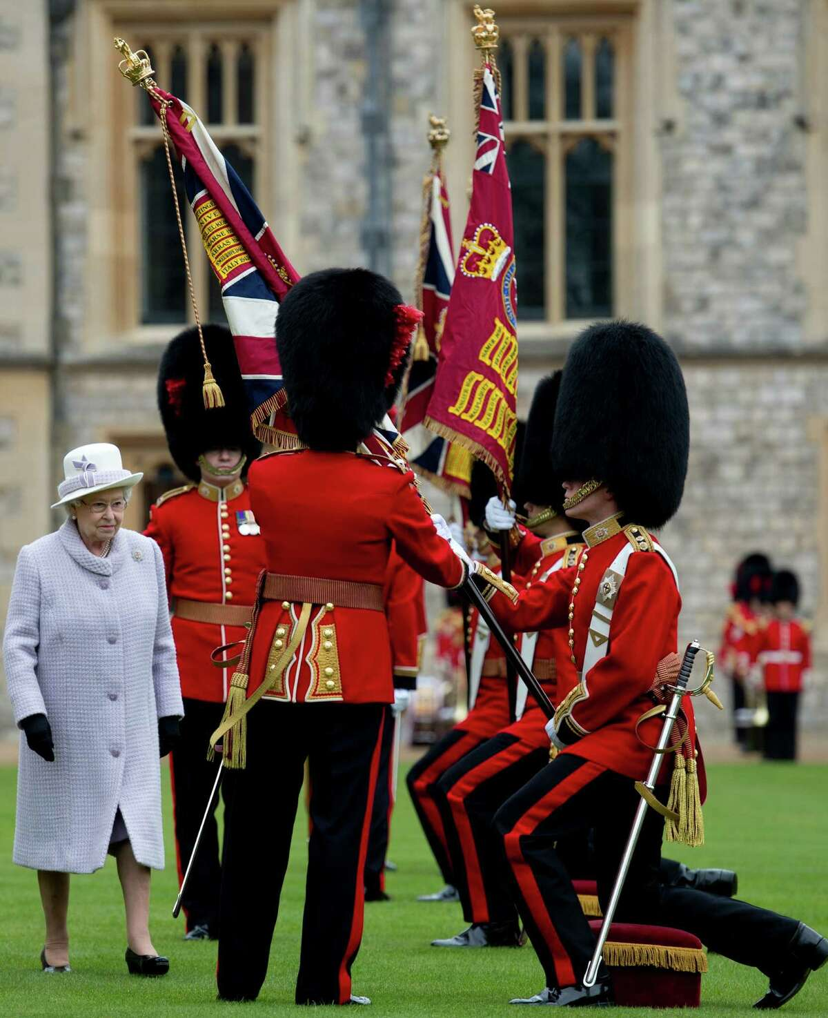 Britain's Queen Elizabeth II (L) presents New Colours to the 1st Battalion and No. 7 Company the Coldstream Guards at Windsor Castle, Berkshire, west of London, on May 3, 2012. The Queen presented New Colours to the 1st Battalion and No. 7 Company of the Coldstream Guards and then inspected the Parade. The Coldstream Guards, the oldest regiment in the British Army, will form part of the guard for Trooping the Colour in honour the the Queen's birthday in June following which the regiment will prepare for deployment to Afghanistan once more. AFP PHOTO / POOL / BEN STANSALLBEN STANSALL/AFP/GettyImages