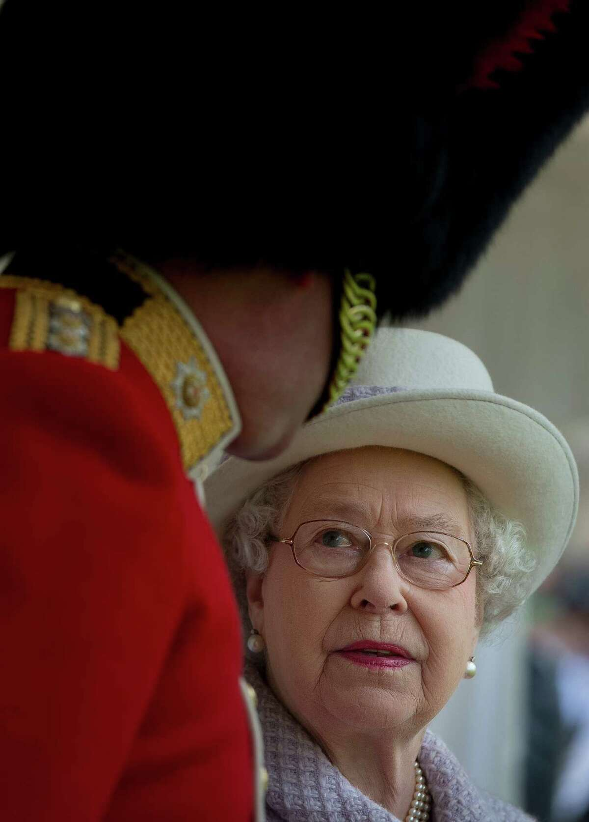 Britain's Queen Elizabeth II (R) talks with an officer as she watches a ceremony in which she presented New Colours to the 1st Battalion and No. 7 Company the Coldstream Guards at Windsor Castle, Berkshire, west of London, on May 3, 2012. The Queen presented New Colours to the 1st Battalion and No. 7 Company of the Coldstream Guards and then inspected the Parade. The Coldstream Guards, the oldest regiment in the British Army, will form part of the guard for Trooping the Colour in honour the the Queen's birthday in June following which the regiment will prepare for deployment to Afghanistan once more. AFP PHOTO / POOL / BEN STANSALLBEN STANSALL/AFP/GettyImages