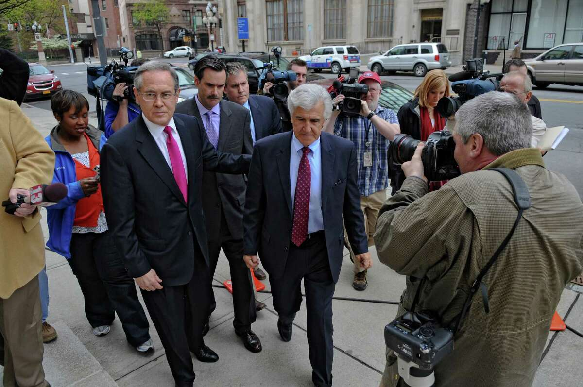 Former Senate Majority Leader Joseph Bruno emerges from a vehicle on Broadway to appear in Federal Court on Thursday May 3, 2012 in Albany, N.Y. Attorney E. Stewart Jones is at left. (Philip Kamrass / Times Union)