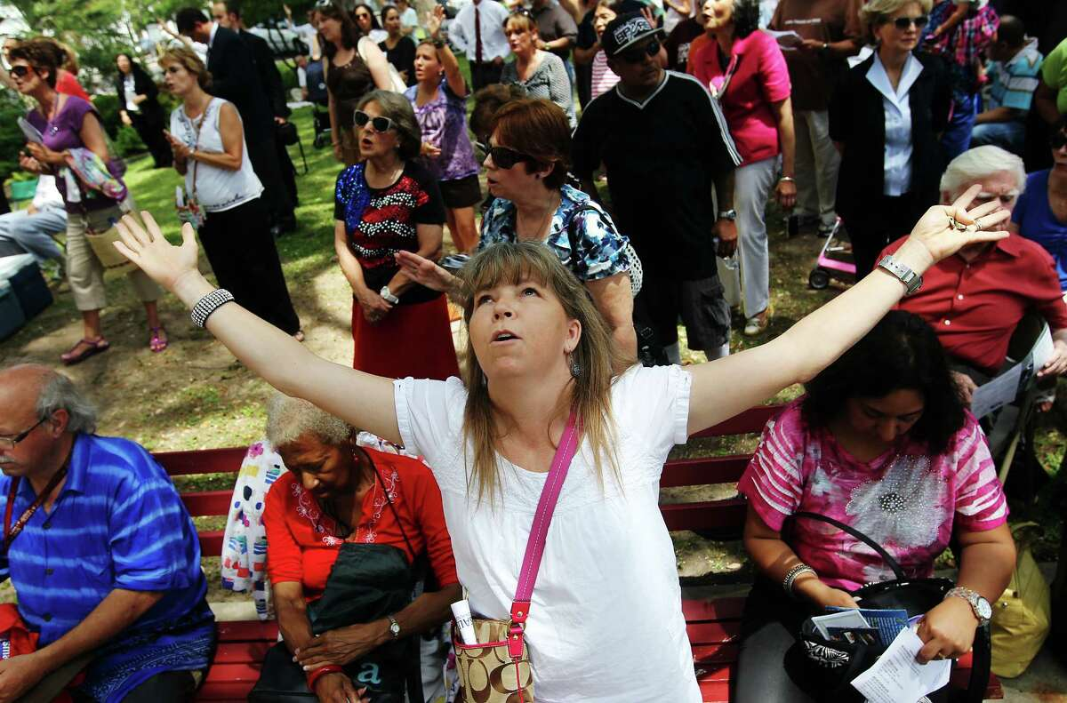 Connie Sowards joins other Christians in prayer at the steps of City Hall for National Day of Prayer on Thursday, May 3, 2012.