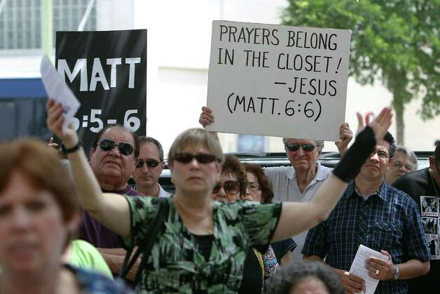 Protestors hold up signs to oppose the National Day of Prayer event at City Hall on Thursday, May 3, 2012. Photo: KIN MAN HUI, San Antonio Express-News / ©2012 San Antonio Express-News