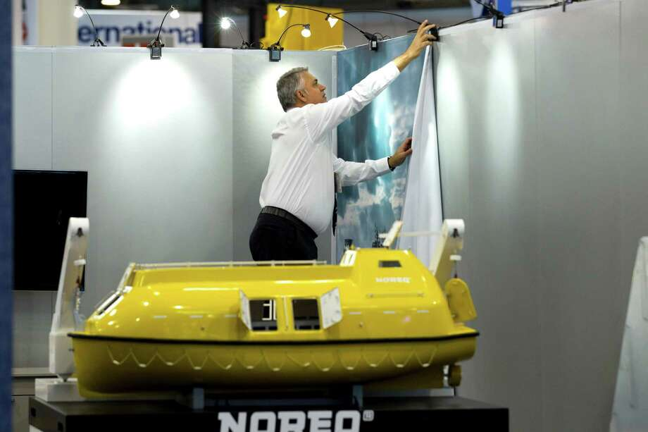 Wellington Barros takes down the Noreq booth at the end of the 2012 Offshore Technology Conference Thursday, May 3, 2012, in Houston. Photo: Brett Coomer, Houston Chronicle / © 2012 Houston Chronicle