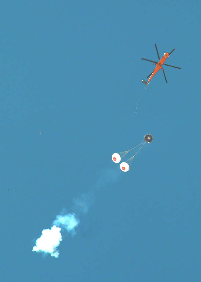 Boeing's Crew Space Transportation (CST)-100 spacecraft deploys its parachutes after being dropped from an Erickson Air Crane helicopter on May 2, 2012 at the Delamar Dry Lake Bed, near Alamo, Nev. / The Boeing Co.