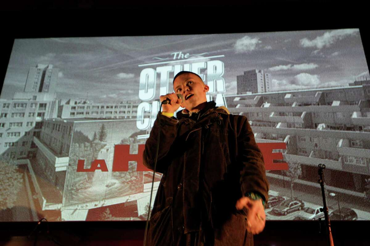 This Wednesday, May 2, 2012 photo poet, Sonny Green recites a poem before a free screening of