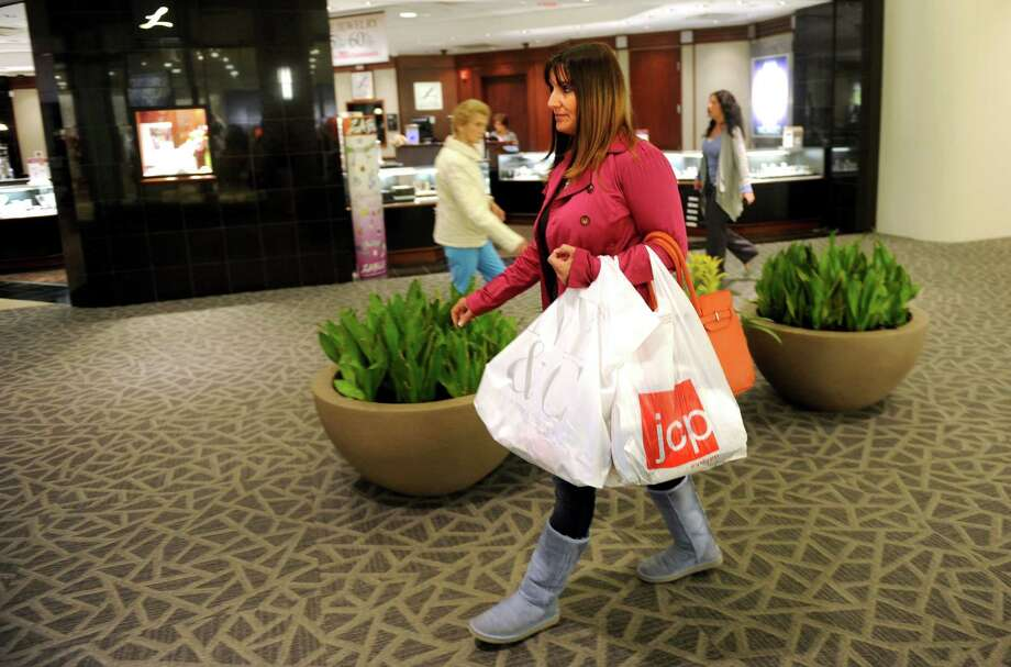 Helena Machado, of Trumbull, shops at the Westfield Trumbull Mall Thursday, May 3, 2012.  Machado, a mother of 6, says she visits the mall daily. Photo: Autumn Driscoll / Connecticut Post