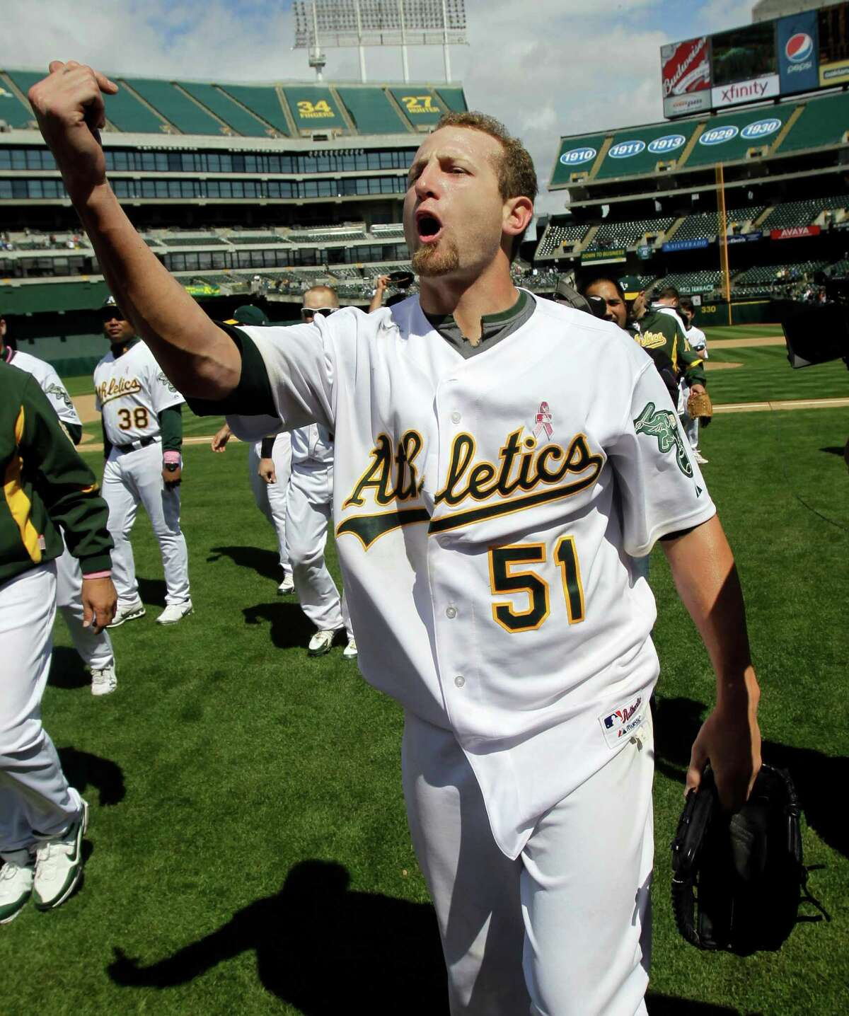 Oakland Athletics starting pitcher Dallas Braden celebrates after throwing a perfect game against the Tampa Bay Rays during a baseball game in Oakland, Calif. Sunday, May 9, 2010. Braden pitched the 19th perfect game in major league history, a dazzling performance for the Athletics in a 4-0 victory over the Tampa Bay Rays on Sunday. (AP Photo/Marcio Jose Sanchez)