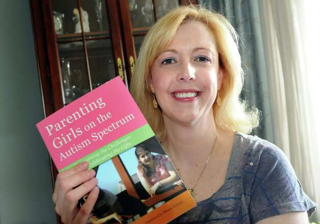 "Eileen Riley-Hall with her book entitled ""Parenting Girls on the Autism Spectrum."" on Saturday, April 28, 2012, at her home in Ballston Lake, N.Y. (Cindy Schultz / Times Union) Photo: Cindy Schultz / 00017463A"