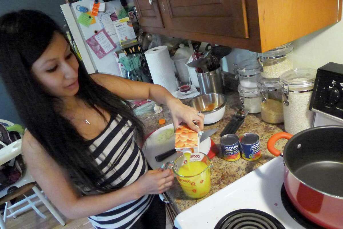 Lilly Kahrs makes dinner for her family in Troy N.Y. Tuesday April 17, 2012. (Michael P. Farrell/Times Union)