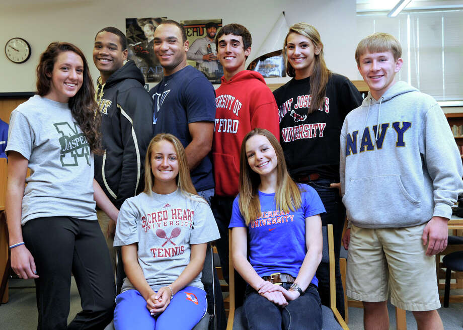 A group of Danbury High School senior college-bound student-athletes gathered in the DHS Media Center on Thursday morning to discuss their college plans. Pictured are, standing from left, Victoria Doyle (Manhattan College, lacrosse); Aaron Dixon (Bryant University, football); Austin Calitro (Villanova University, football);  Chris Del Debbio (University of Hartford, baseball); Casey Smith (St. Joseph's University, basketball) and Tom Moore (United States Naval Academy, cross country, indoor and outdoor track). Seated from left are, Lindsey Post (Sacred Heart University, tennis); and Maddie Daly (American University, cross country, indoor and outdoor track). Photo: Carol Kaliff / The News-Times