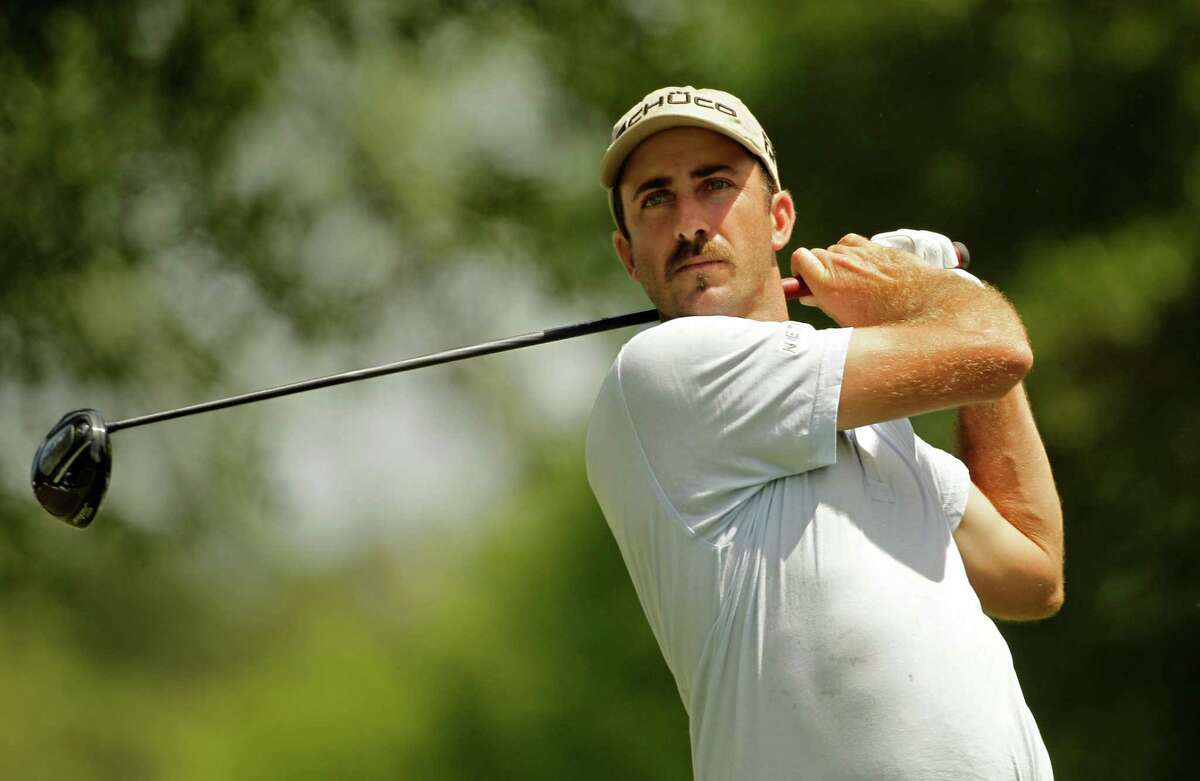 Geoff Ogilvy, of Australia, watches his tee shot on the fourth hole during the first round of the Wells Fargo Championship golf tournament at Quail Hollow Club in Charlotte, N.C., Thursday, May 3, 2012. (AP Photo/Chuck Burton)