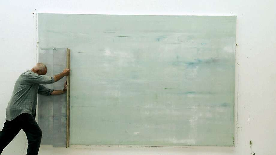 "Gerhard Richter working on ""Abstract Painting (911-4)"" in, ""Gerhard Richter Painting."" Photo: Kino Lorber"