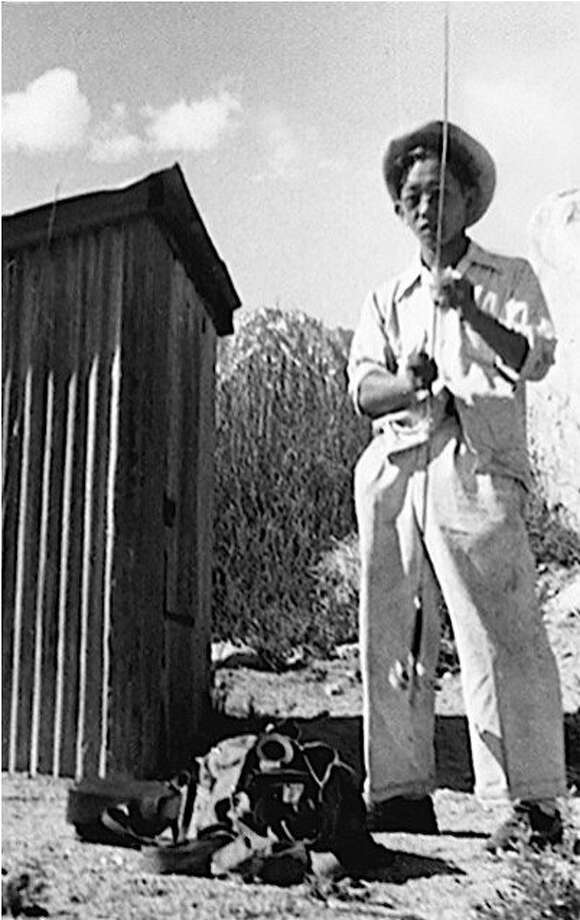 "An image of teenager Archie Myatake at Symmes Creek, c. 1945, is seen from the film, ""The Manzanar Fishing Club."" Photo: Amos Hashimoto"