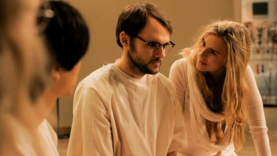Actor Christopher Denham as ÒPeterÓ and writer/actress Brit Marling as ÒMaggieÓ on the set of SOUND OF MY VOICE. Photo: Fox Searchlight