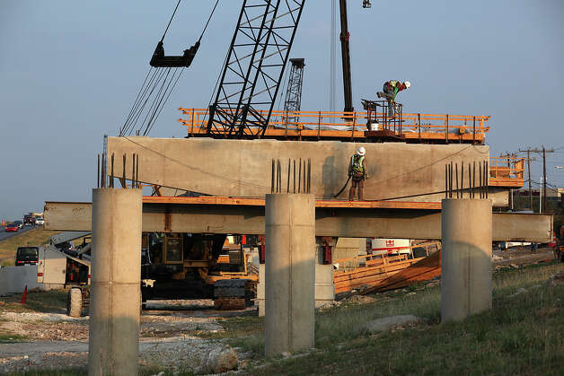 METRO -- Construction continues on the U.S. 281 and Loop 1604 interchange as workers remove a wood frame from support columns, Tuesday, July 19, 2011. The $130 million project was the target of a lawsuit by Aquifer Guardians in Urban Areas that claimed it violated the Endangered Species Act and threaten the Edwards Aquifer. JERRY LARA/glara@express-news.net Photo: JERRY LARA, San Antonio Express-News / SAN ANTONIO EXPRESS-NEWS