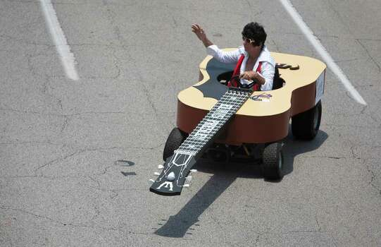 Bob Wink, of Houston, drives Elvis Rocks, during the 2011 parade. Photo: Nick De La Torre / © 2010 Houston Chronicle