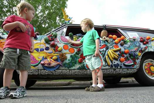 Jake Miers, left, and Nicolas Gioco, both 3 and of Houston, get a better look at an Art Car in 2010. Photo: Nick De La Torre / Houston Chronicle