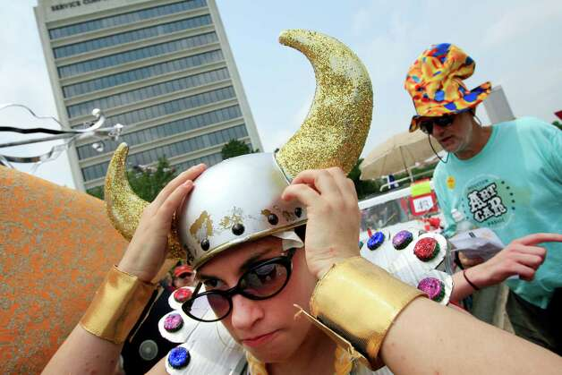 Holly Beretto, of the Houston Grand Opera, adjusts her costume at the 2008 parade. Photo: Eric Kayne / Houston Chronicle