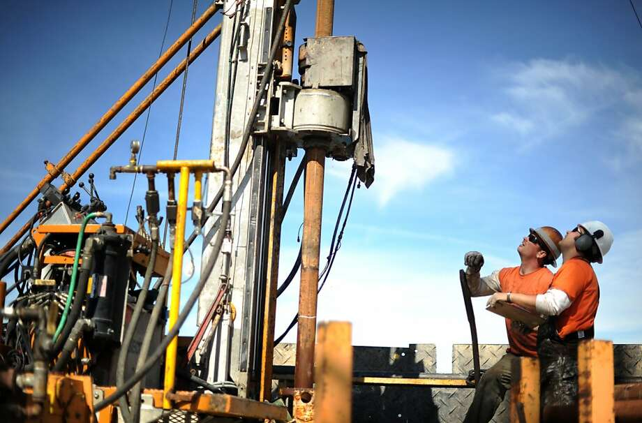 Jess Valeda (L) and Ryan OÕGrady of the Utah-based DOSECC (Drilling Observation and Sampling of the Earths Continental Crust) are drilling about 120 meters into the bottom of Clear Lake in Lake County, California for samples of ancient sediment as part of a project to study climate change lead by UC Berkeley scientists. April 30, 2012. Photo: Erik Castro, Special To The Chronicle