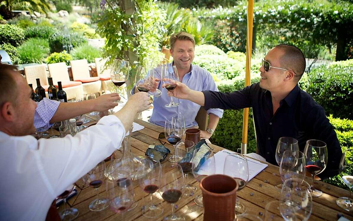 Jack Bittner, president of Cliff Lede Vineyards (left in white shirt), Jan-Hendrik Schlottmann (center in light blue shirt) and fashion designer Derek Lam toast to their successful blend.