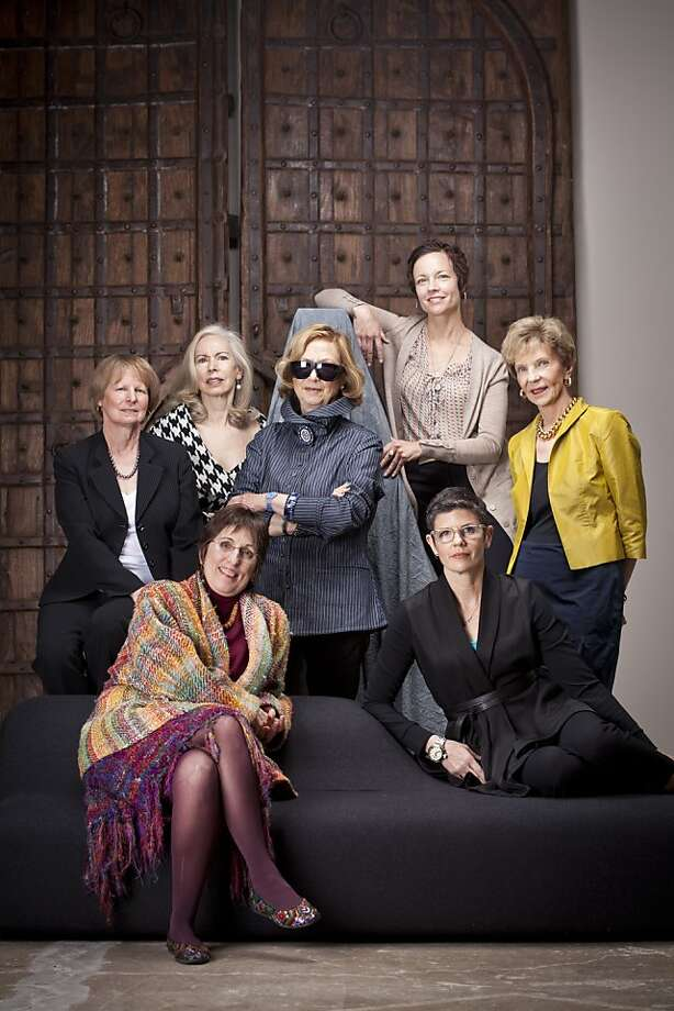 Design school chairwomen are:  (front row from left) Bo Breda of the Art Institute of California and Amy Williams of the California College of the Arts (middle row from left) Nancy Rabolt of San Francisco State University,  Gladys Perint Palmer of Academy of Art University, and Mary Stephens of FIDM/Fashion Institute of Design & Merchandising, (back row) Diane Green of City College of San Francisco and Suzy Furrer of Apparel Arts.  They're seen in front of 19th century doors from India, $40,000 at DZINE.  The Seasons chaise by Viccarbe, designed by Viccarbe, available in two sizes and sold exclusively by DZINE from $3032. Photo: Russell Yip, The Chronicle