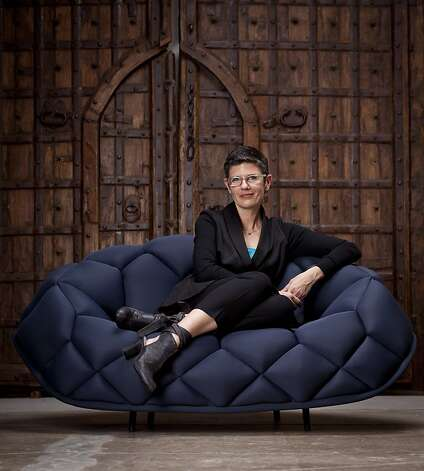 Amy Williams of the California College of the Arts is seen with the Quilt chair by Established & Sons at DZINE in San Francisco, Calif., on April 25, 2012.  Designed by Ronan & Erwan Bouroullec, the chair is sold for $6,060 exclusively through DZINE. Photo: Russell Yip, The Chronicle