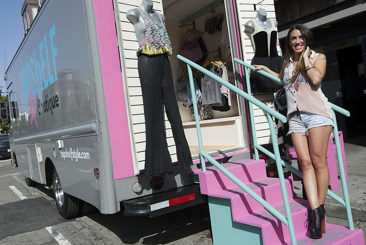 Christina Ruiz stands outside of her mobile fashion boutique, Topshelf, as she is parked in front of Bloodhound Bar on Folsom Street in San Francisco, Saturday afternoon, April 28, 2012.