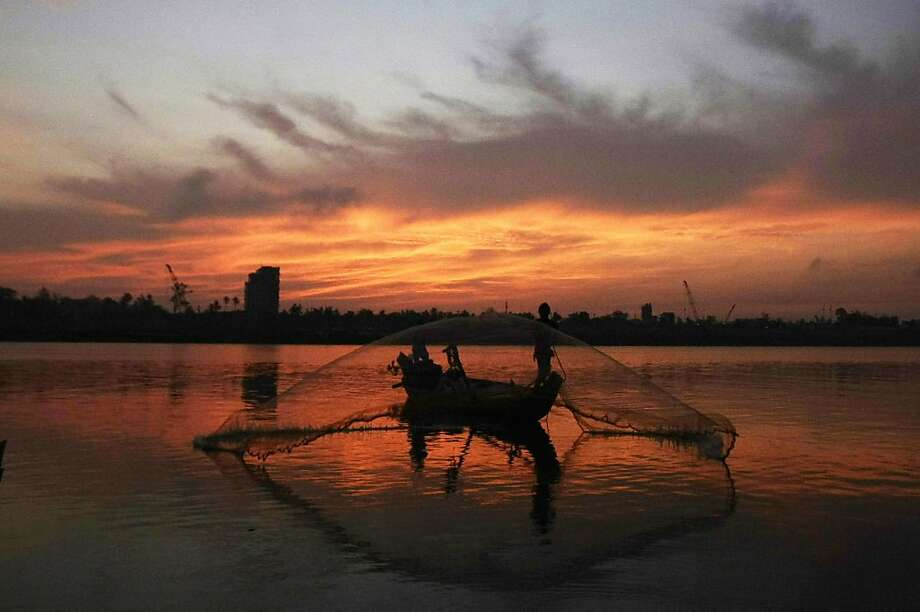 For many fishermen in Cambodia, their livelihood depends on Tonle Sap River flows, which could be blocked by a hydroelectric dam neighboring Laos is building on the Mekong River. Photo: Heng Sinith, Associated Press