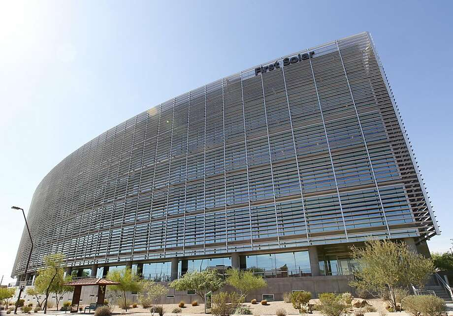 This Wednesday, April 18, 2012 photo shows First Solar Inc's corporate headquarters in Tempe, Ariz. First Solar Inc will lay off 2,000 workers and close it's factory in Germany following a collapse in solar panel prices. First Solar is America's biggest solar manufacturer and the layoffs amount to 30 percent of its global workforce. (AP Photo/Matt York) Photo: Matt York, Associated Press