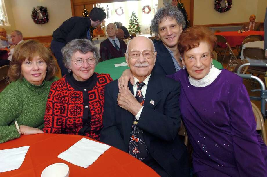 John Sorrento, center, celebrating his 100th birthday with, from left, niece Mary Ann Tammaro, of Port Chester, N.Y., daughter Gwen Horvath, of North Branford, stepson Carmine Marino, of Stamford, and wife Dorothy Marino Sorrento, 79, at a gathering at the Redmen's Club in December 2006. Longtime Pemberwick resident and town employee John Sorrento, the custodian at Town Hall and the first parking meter attendant when it cost one cent to park, died recently. He was 106. Photo: Neafsey,Helen, GT / 00001444A