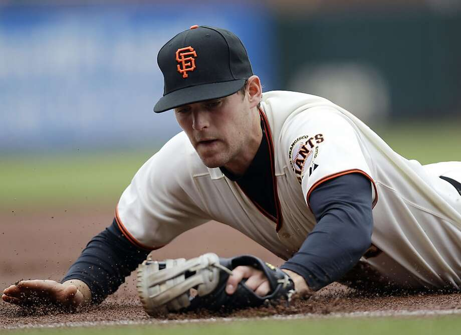 San Francisco Giants third baseman Conor Gillaspie makes a diving stop on a ground ball by Miami Marlins' Emilio Bonifacio during the first inning of a baseball game in San Francisco, Thursday, May 3, 2012. Bonifacio was safe on Gillaspie's ensuing throw to first base. (AP Photo/Marcio Jose Sanchez) Photo: Marcio Jose Sanchez, Associated Press